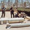 Equipe da ONU realiza inspeções destinadas a descartar a capacidade de armas químicas, biológicas e nucleares do Iraque. (1991)