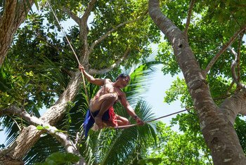 An Egongot indigenous man balances on a yantok vine as he crosses from one tree to another in Dipaculao, Aurora, in the Philippines. (23 March 2019)