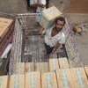 Workers stack food assistance in a warehouse in Lahj, Yemen. ( 1 July 2019)