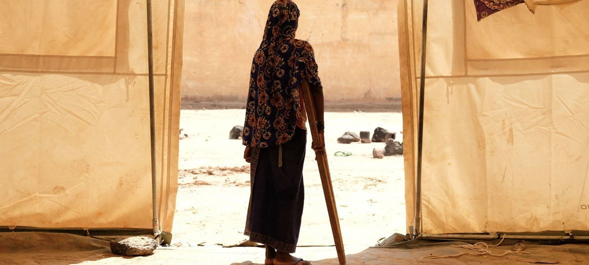 A girl uses a crutch to walk around a displacement camp in Sévaré, in the Mopti Region of Mali. (June2019)