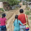 Nine-year-old Acnayeli (center) fled violence in Venezuela and lives now with her mother and sister in in Cucuta, Colombia. (April 2019)
