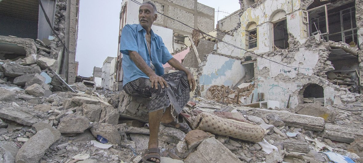 Shaker Ali sits in front of what used to be a marketplace in Aden, Yemen. (22 June 2019)