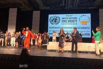 Yinka Lamboginny performs at the 68th UN Civil Society Conference in Salt Lake City, Utah. (27 August 2019)