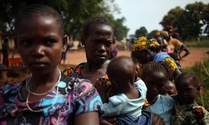 Women who fled violence and in the Central African Republic queue with their children to receive treatment at a UNICEF-supported clinic.