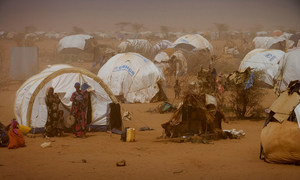Women and children stand outside temporary tents at a refugee camp near the Kenya-Somalia border. (file photo)
