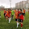 In Turkey, young women play in a soccer match to end violence against women and girls.