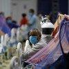 नई दिल्ली के राष्ट्रमण्डल खेल गाँव में कोविड-19 उपचार केन्द्र में मरीज़ों का इलाज हो रहा है.