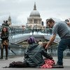 A homeless woman begs for money in the centre of London, United Kingdom