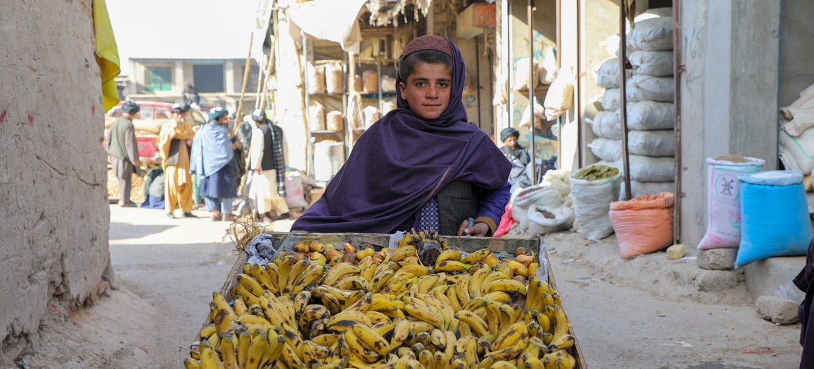 A 12-year-old boy, who does not spell  to school, sells bananas successful  Uruzgan Province successful  occidental  Afghanistan.