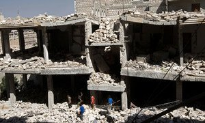 Boys wander amid rubble of destroyed buildings in Idlib, Syria. (file)