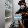 COVID-19 vaccine vials are stored in a government-run facility in New Delhi, India.
