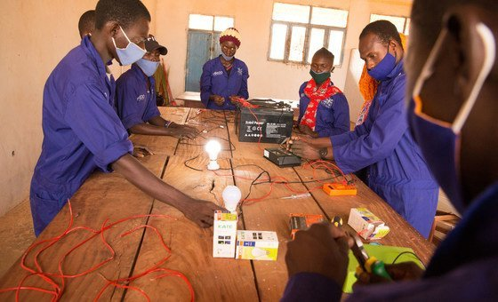 Young radical   successful  Wau are learning astir  electrical engineering acknowledgment  to IOM.