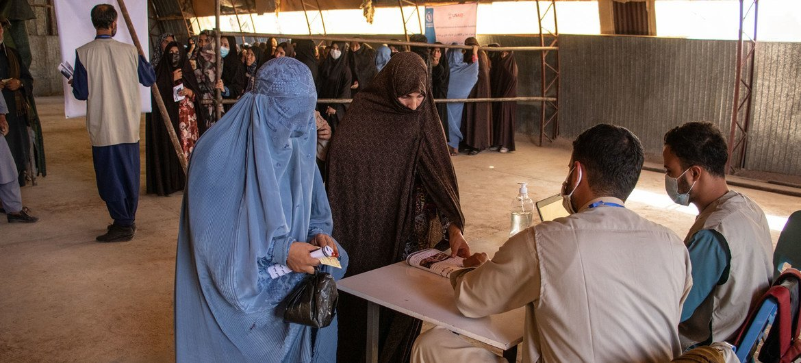 Households register for food rations at a food distribution site in Herat, Afghanistan.