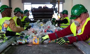 Women sort plastic at a recycling plant in Jordan.
