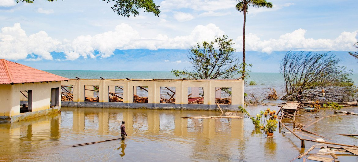 A man wades through what is left of Bujumbura's nautical centre.