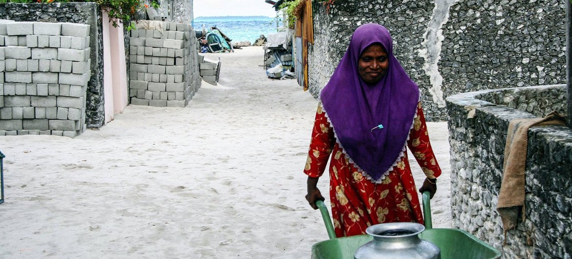 Water shortages exacerbated by clime  alteration  are affecting the Maldives' low-lying islands.