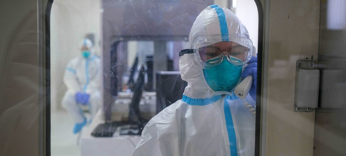 Medical technicians test the equipment inside a sterile lab during the inauguration of a new facility in the Philippines focused on pandemic research.
