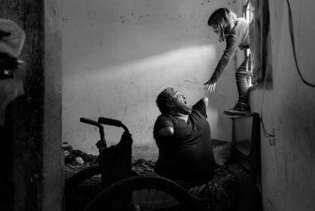 A father plays with his daughter during the COVID-19 pandemic in Buenos Aires, Argentina.