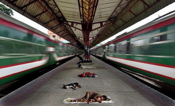 In Bangladesh, people sleep rough in dangerous and unhealthy conditions at a train station in Chittagong.