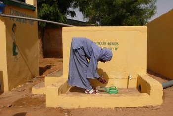 A girl washes her hands at a primary school in Zamfara State, Nigeria.