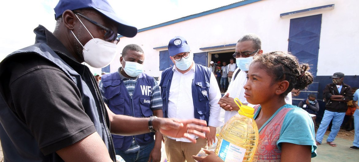Issa Sanogo, UN Resident Coordinator successful  Madagascar, meets a young miss  who had received nutrient  aid.
