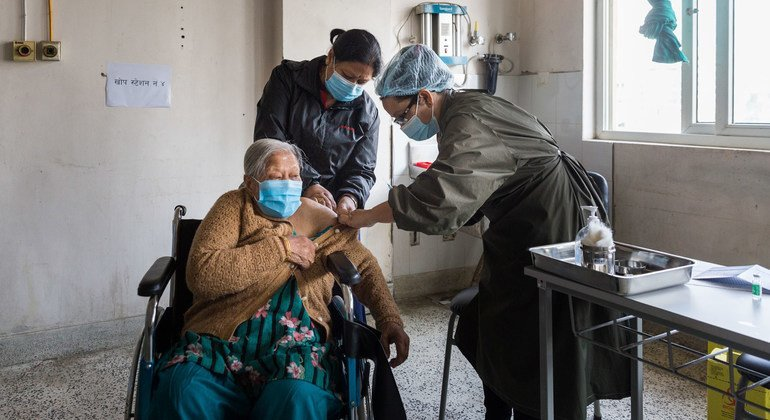 An elderly woman receives her COVID-19 vaccination at a hospital in Kathmandu, Nepal.