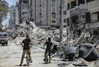 A tower block lies in ruins in Gaza city following an Israeli air strike.