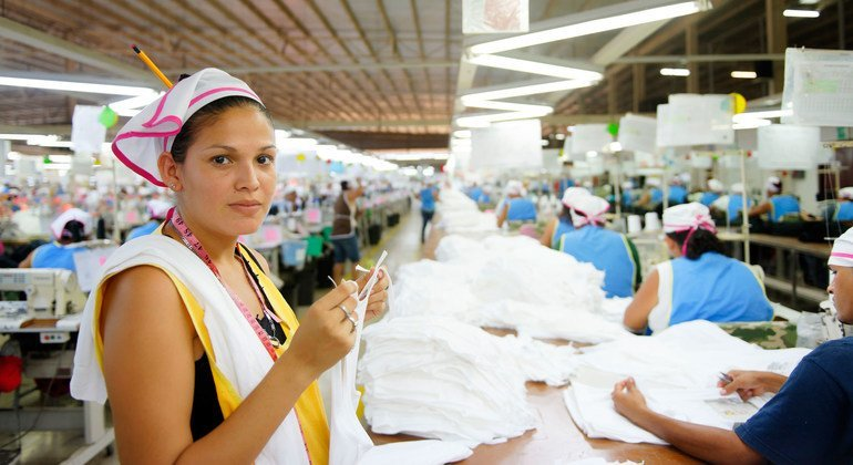 A garment worker inspects clothing in a factory in Nicaragua.
