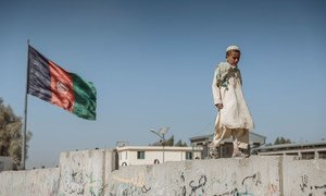 A young boy walks along the Spin Boldak-Chaman border of Afghanistan and Pakistan in February 2021.