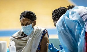 In developing countries like Rwanda, high-risk populations are being prioritized for protection against COVID-19.