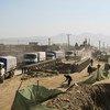 Los camiones del Programa Mundial de Alimentos de la ONU salen de Kabul en mayo de 2021 para entregar alimentos a las comunidades vulnerables.