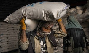 Grain is loaded for distribution at a World Food Programme warehouse in Kabul in May 2021.