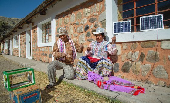 Villagers in the Peruvian village of Sibayo, use a solar-powered spinning machine.