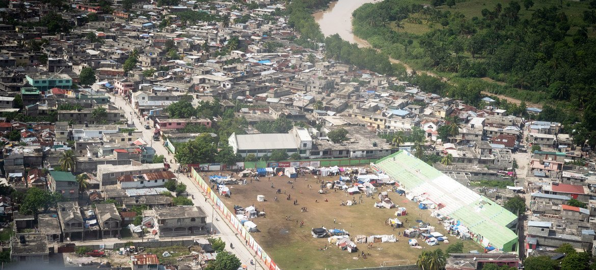 A sports field in Les Cayes is being used as a temporary camp for people displaced by the recent earthquake in Haiti.