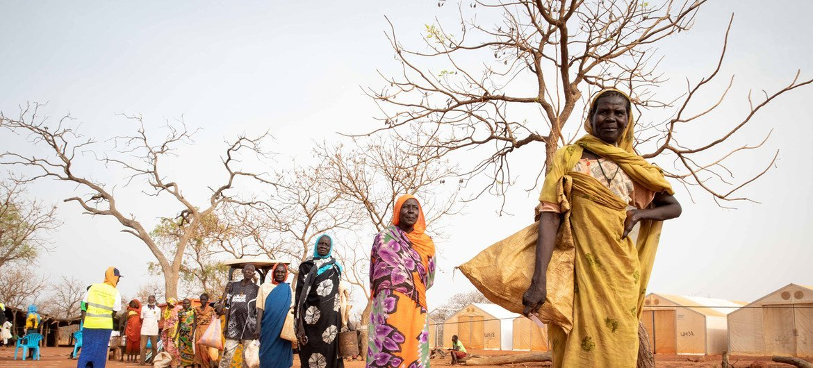Refugees practice physical distancing st a camp in South Sudan