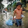 A boy drags possessions through the flooded streets of Manila in the aftermath of a typhoon. (file)