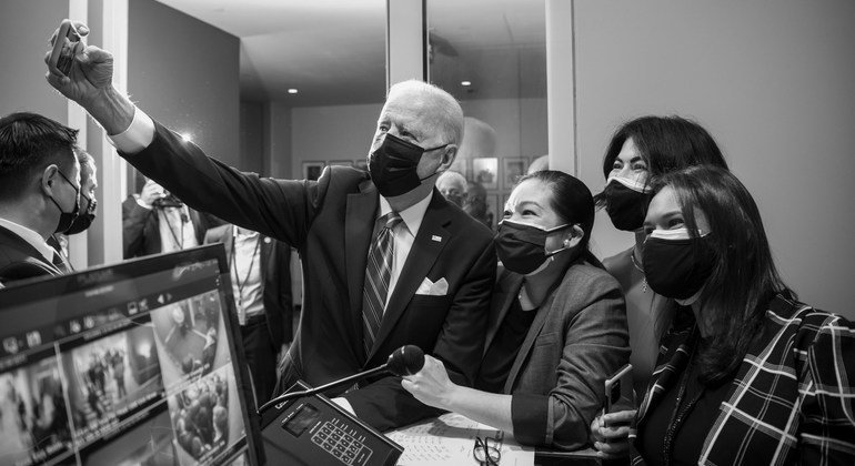 Joe Biden, President of the United States of America, takes a selfie photo with UN staff.