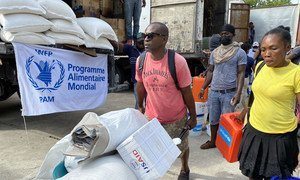 Haitians impacted by the recent earthquake in Les Cayes receive relief supplies for humanitarian agencies.