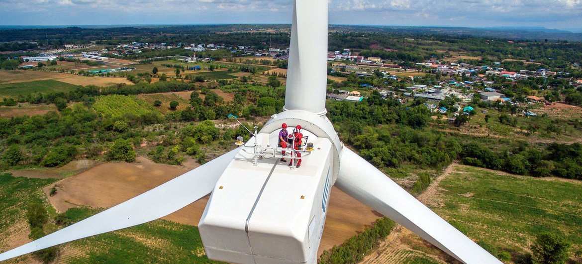 Workers on a wind turbine in Chaiyaphum province, Thailand.