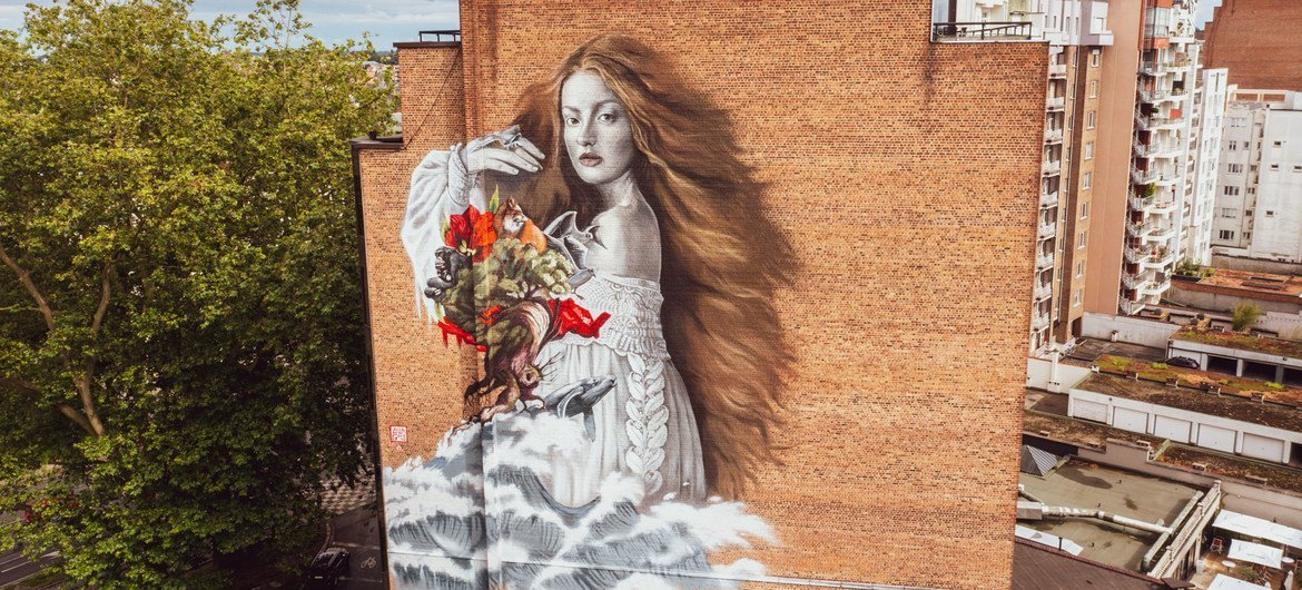 The Alchemist is a 40-metre-high mural which has been painted onto the side of a property in Brussels.