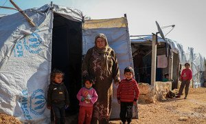 A displaced family living in a makeshift tent in a camp in northern rural Aleppo, Syria.