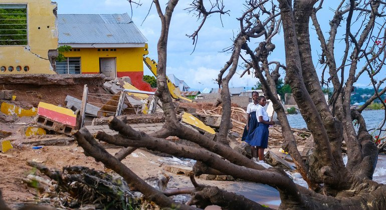 Girls stand outside their storm-damanged school on the shores of Lake Tanganyika in the Democratic Republic of the Congo.