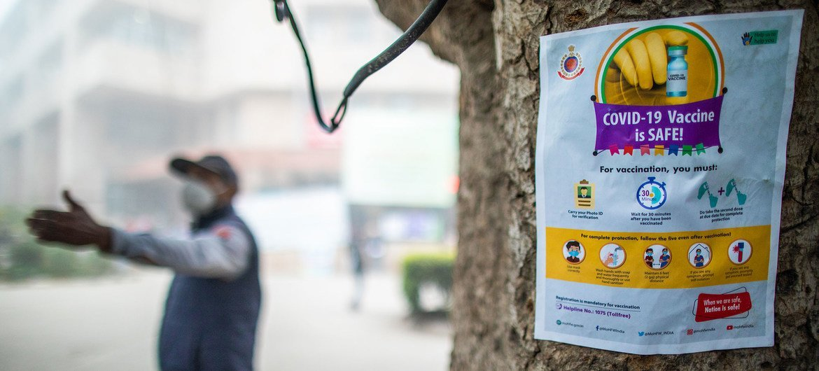 In New Delhi, India, a poster plays a role in dispelling myths about the COVID-19 vaccine.