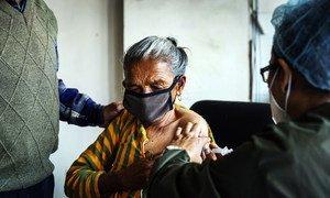 An elderly woman receives a COVID-19 vaccine at Paropakar Maternity and Women's Hospital in Kathmandu, Nepal.