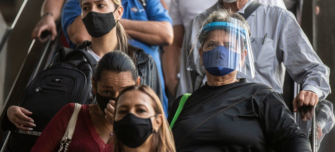 People wear face masks in Medellin, Colombia, to prevent the spread of COVID-19.