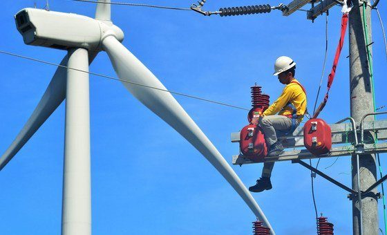 A technician repairs a turbine at a wind farm in the Philippines.