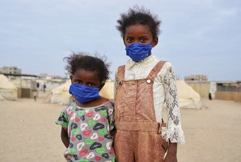 Two young girls who have been displaced due to conflict are now living in a UNHCR-supported settlement in the outskirts of Aden, Yemen.