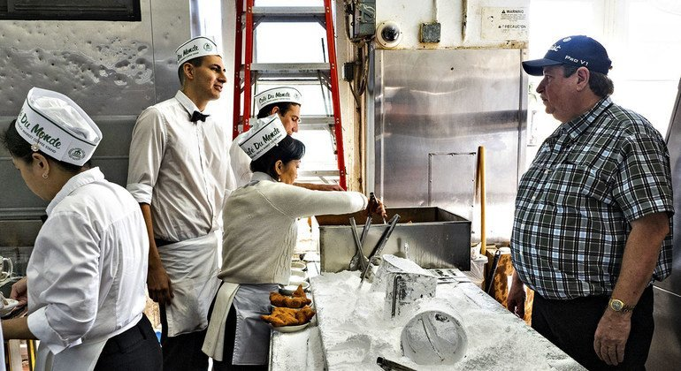 Kenny Swafford (right) talks to his staff in the kitchen of the Café du Monde in New Orleans.