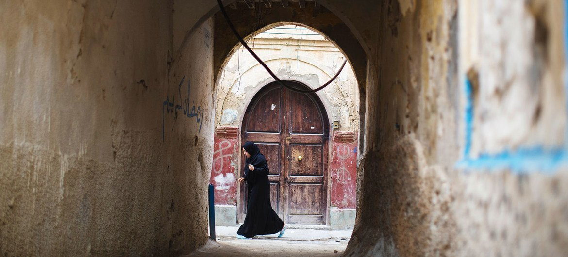 A woman walks in the old city of Tripoli, Libya. (file)