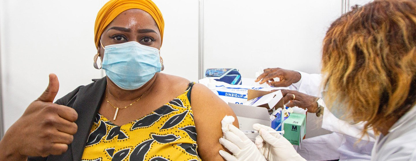 A health worker in Abidjan, Côte d'Ivoire, becomes  one of the first people to receive the COVID-19 vaccine as part of the global rollout of COVAX in Africa.
